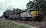Louisville & Nashville SD40-2's 3560, 8026 & 1277 lead a Crystal River 85-car coal train past the old yard 
